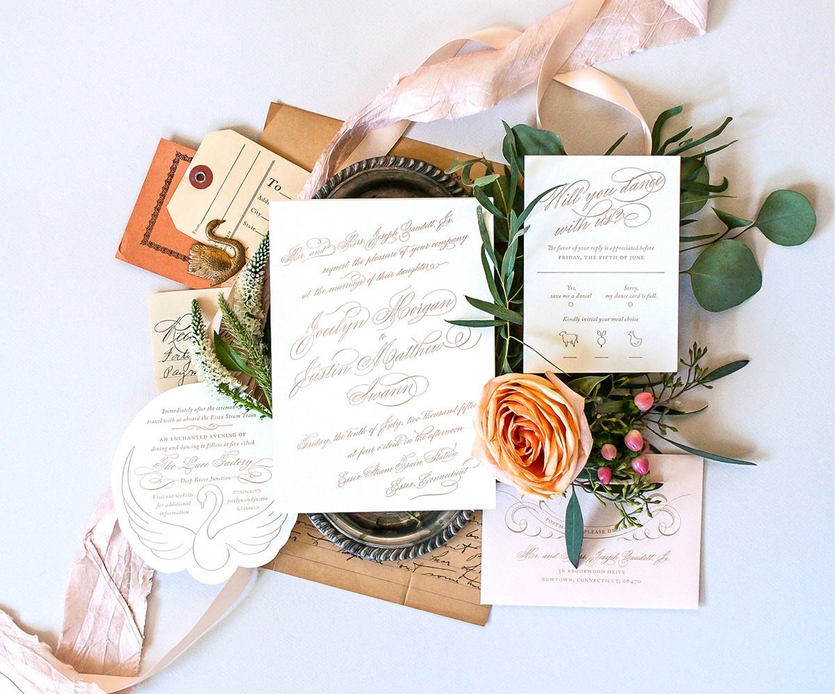 Romantic gold script letterpress wedding invitation with swan detail