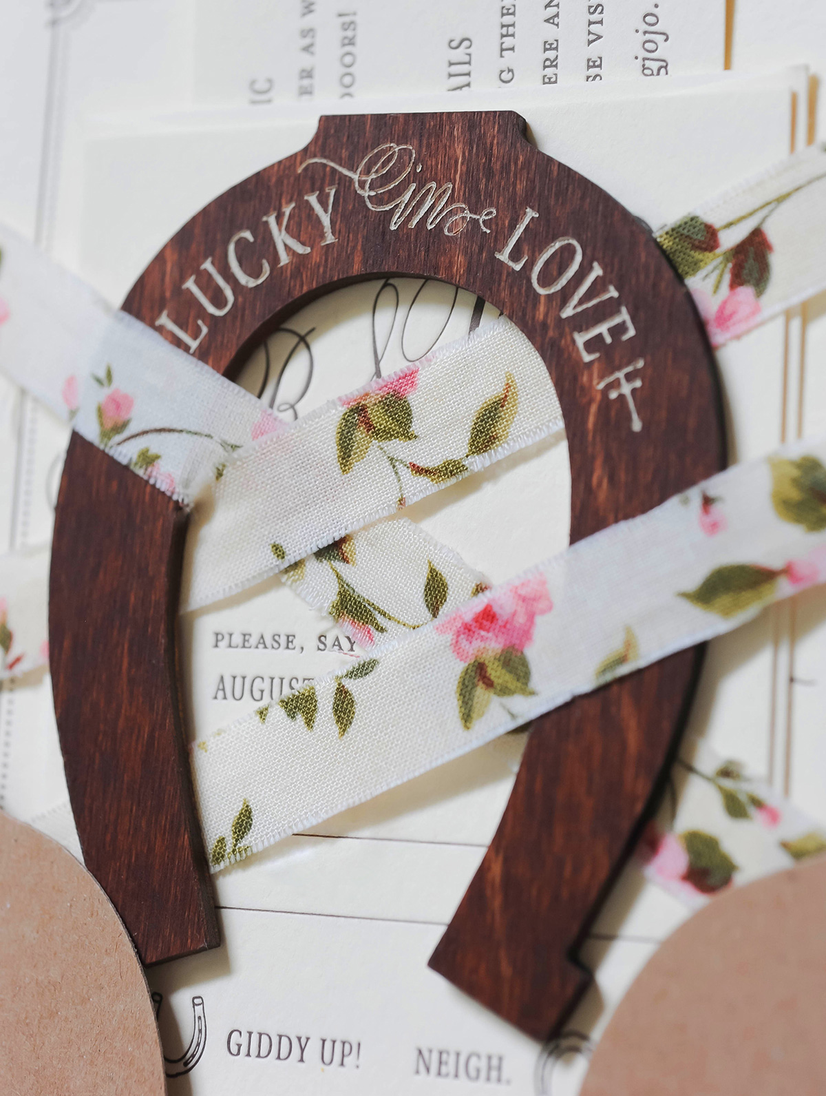 Engraved wooden horseshoe wedding invitation