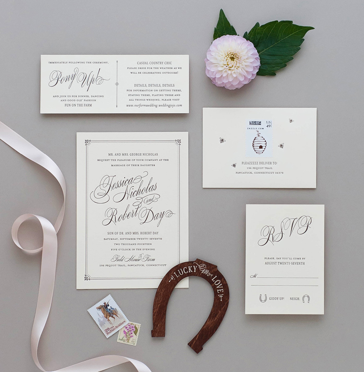 Classic letterpress invitations with calico fabric ribbon and engraved wooden horseshoe