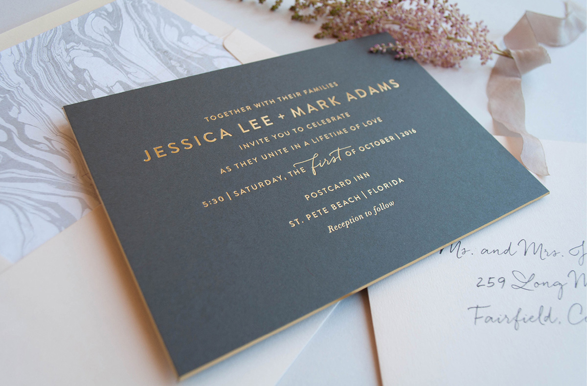 Gold foil stamped modern wedding invitation on grey paper with foil edge