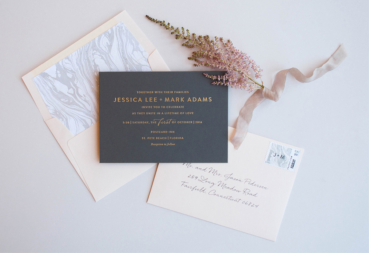 Gold foil stamped modern wedding invitation on grey paper with pink envelope